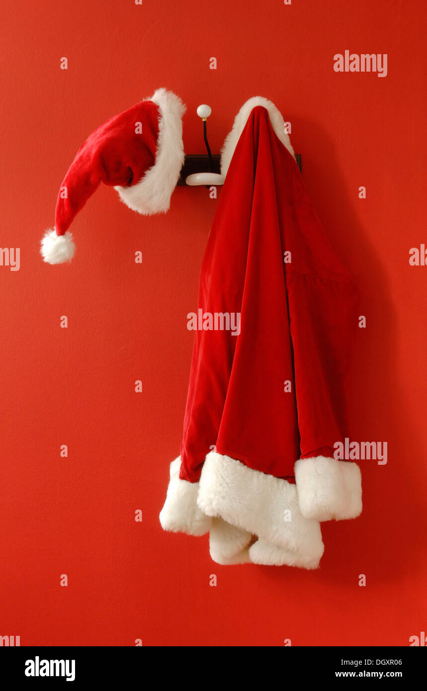 santa claus hat and coat hanging on nostalgic coat hooks stock image - Santa Claus Coat