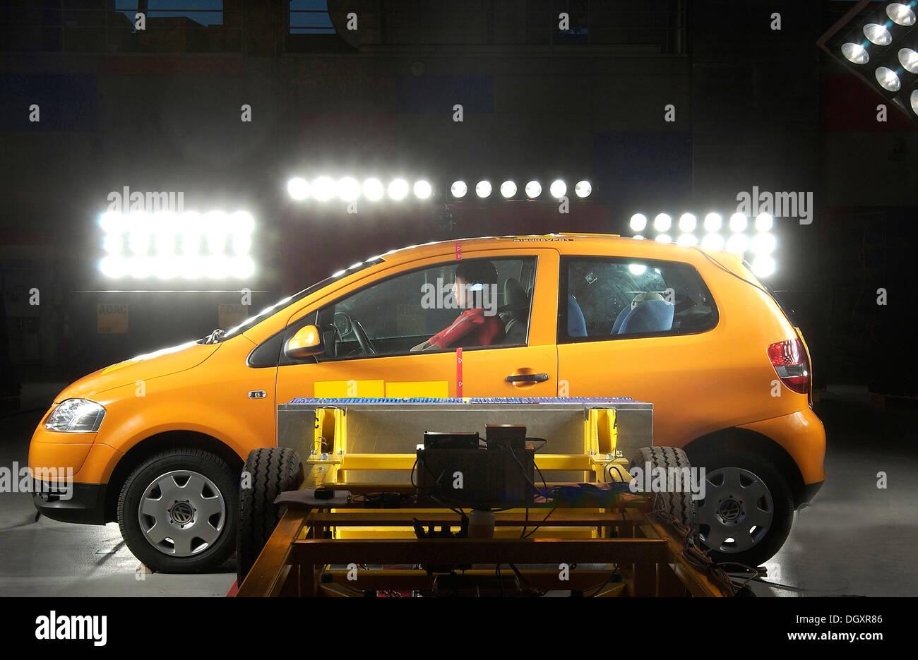 Crash Test Dummies In A Car Behind A Battering Ram Stock Photo