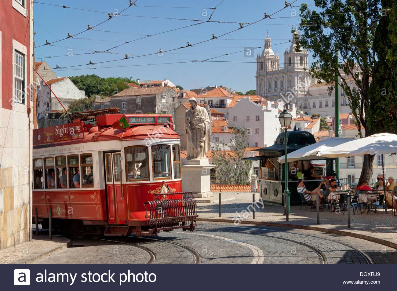 Portugal, Lisbon, a tram and street café, Largo de Santa Luzia - Stock Image