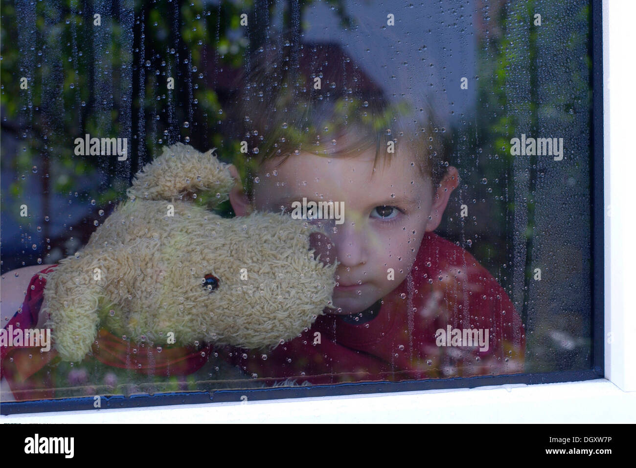 Boy Looking Out Window Sad Stock Photos & Boy Looking Out ...
