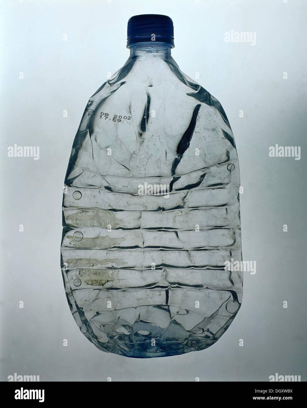 Flattened plastic water bottle - Stock Image
