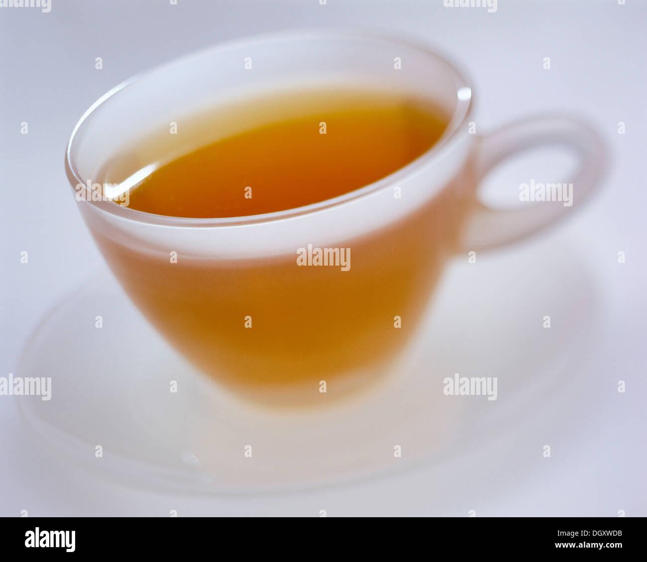 Transparent teacup with green tea - Stock Image
