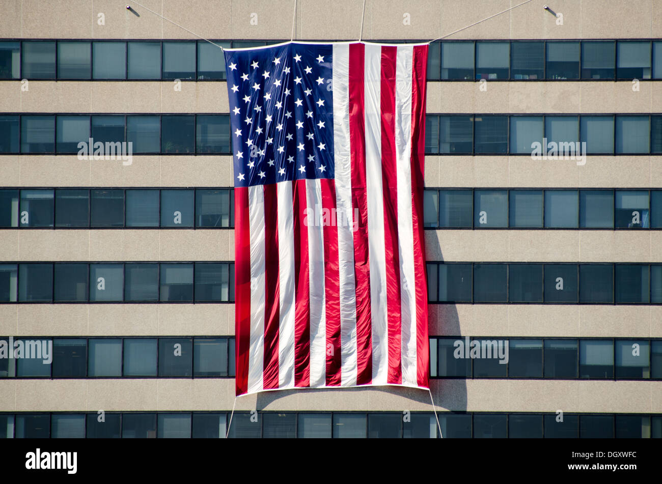 Defense contractors and other business based in Rosslyn, Virginia, drape large flags on the outside of their buildings for the anniversary of the 9/11 terrorist attacks. The Pentagon, which was the target of one of the attacks, is nearby. - Stock Image