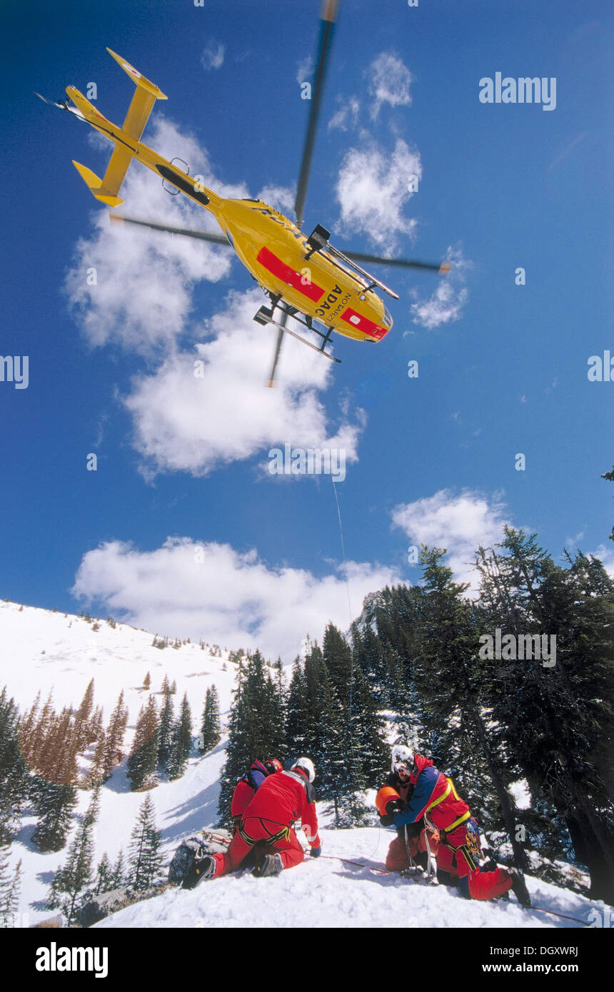 ADAC helicopter during a mountain rescue, Spitzingsee, Schliersee, Upper Bavaria, Bavaria, Germany - Stock Image