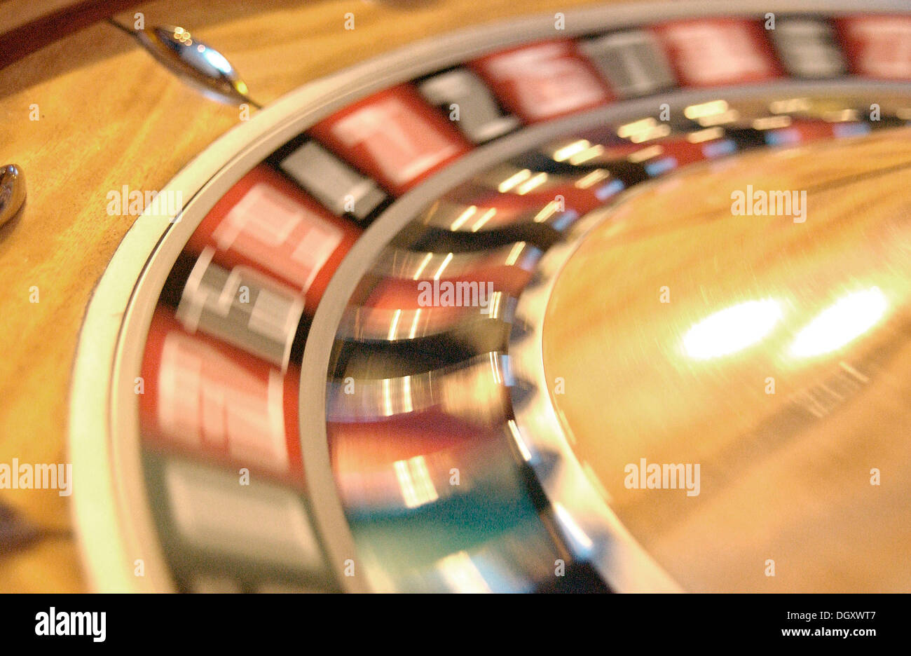 Rotating roulette wheel with motion blur - Stock Image