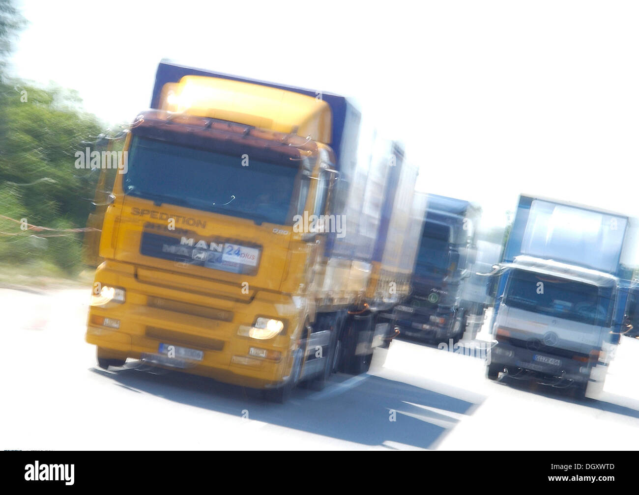 Trucks with motion blur on a road - Stock Image