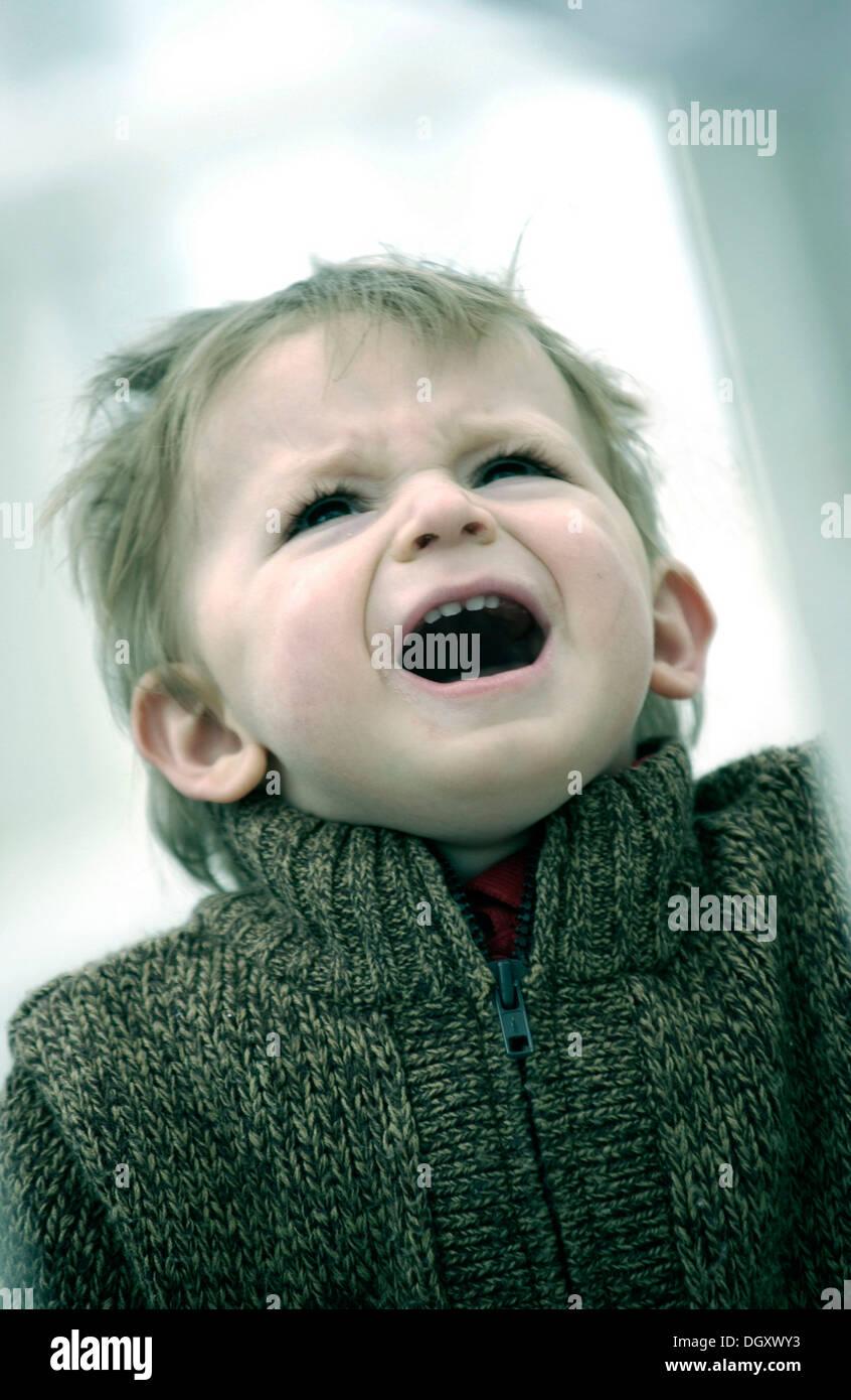 Young boy shouting - Stock Image