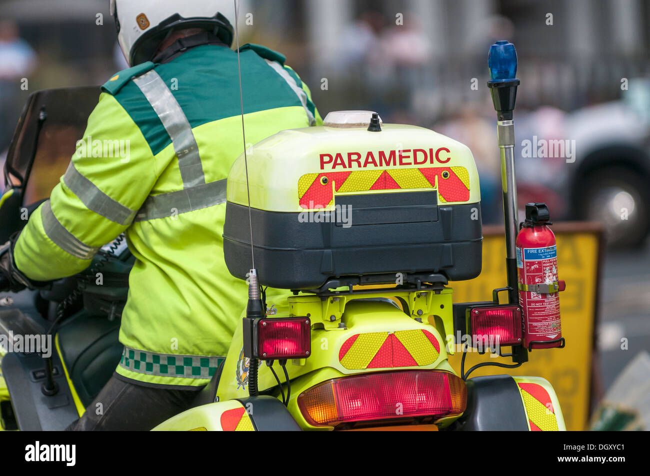 UK Paramedic close up on a motorbike ready to save lives. View from the rear behind. Close up (macro) - Stock Image