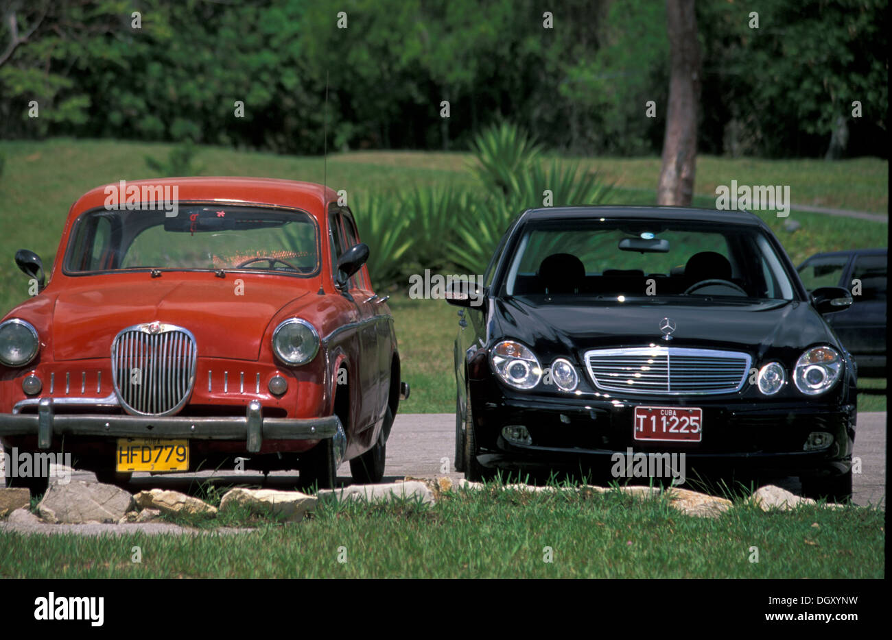 Capitalism and communism, Mercedes and vintage car in Cuba - Stock Image