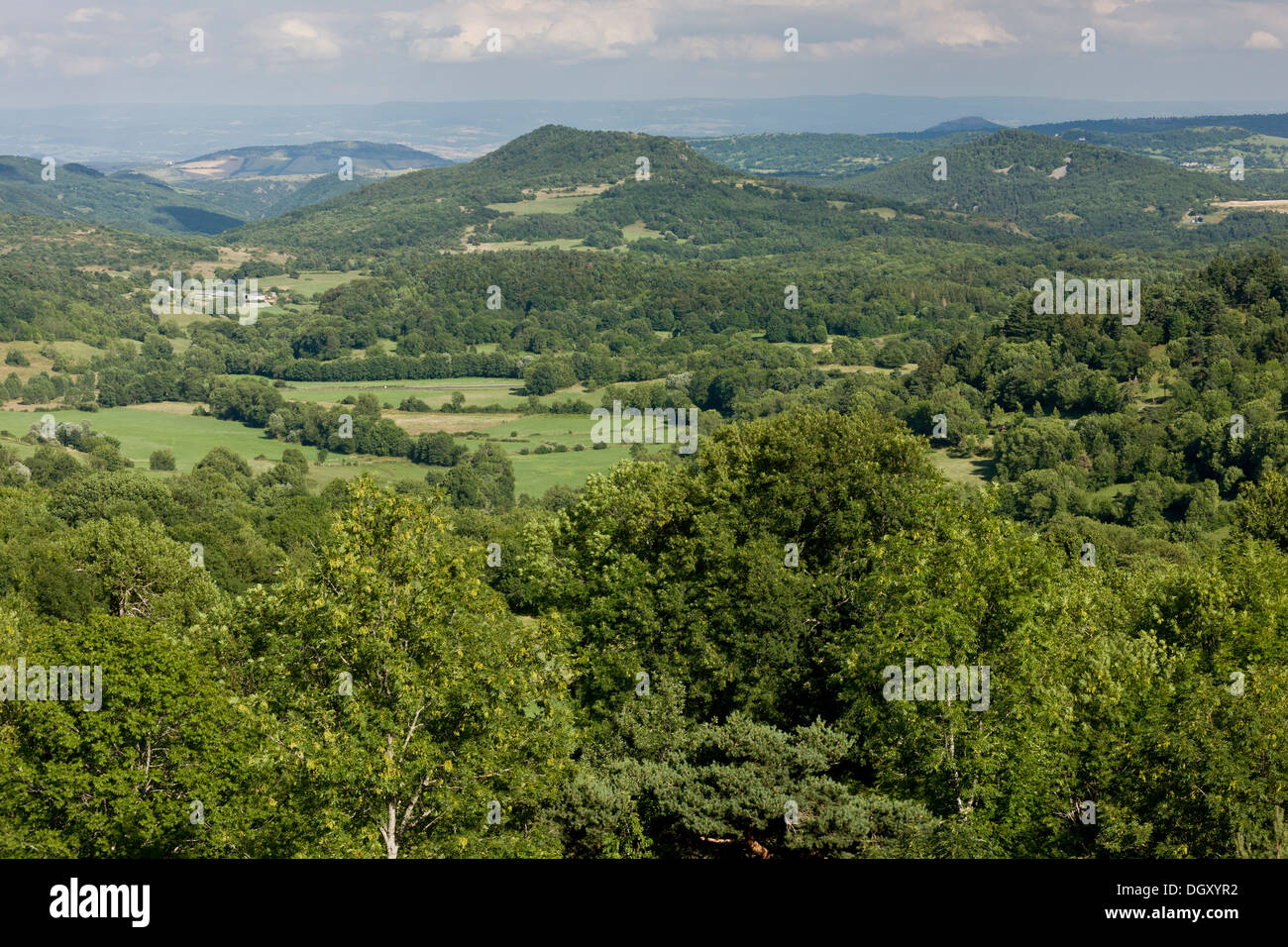 The Auvergne, looking east over rolling wooded volcanic countryside from Murol. - Stock Image