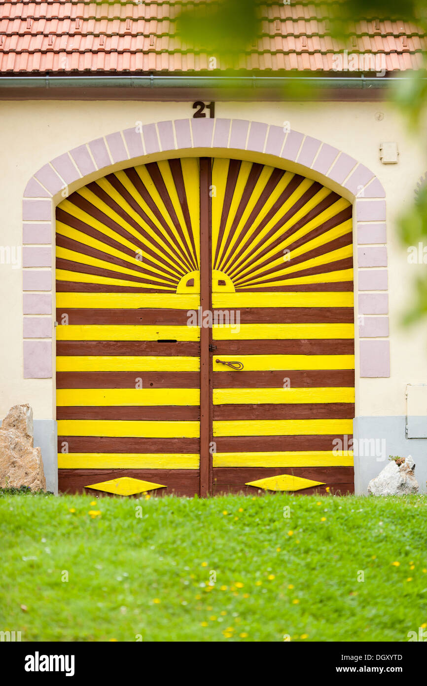 Colorful gate to the house in Holasovice, Czech Republic. - Stock Image