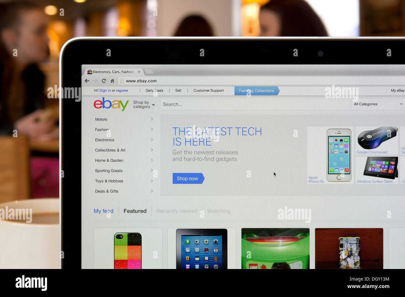 The ebay website shot in a coffee shop environment (Editorial use only: print, TV, e-book and editorial website). - Stock Image