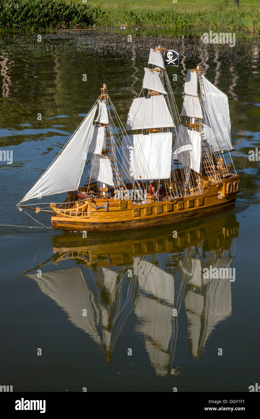 Scale model of a tri-masted square-rigged Spanish galleon sailing ship floating on Lake Dora. - Stock Image