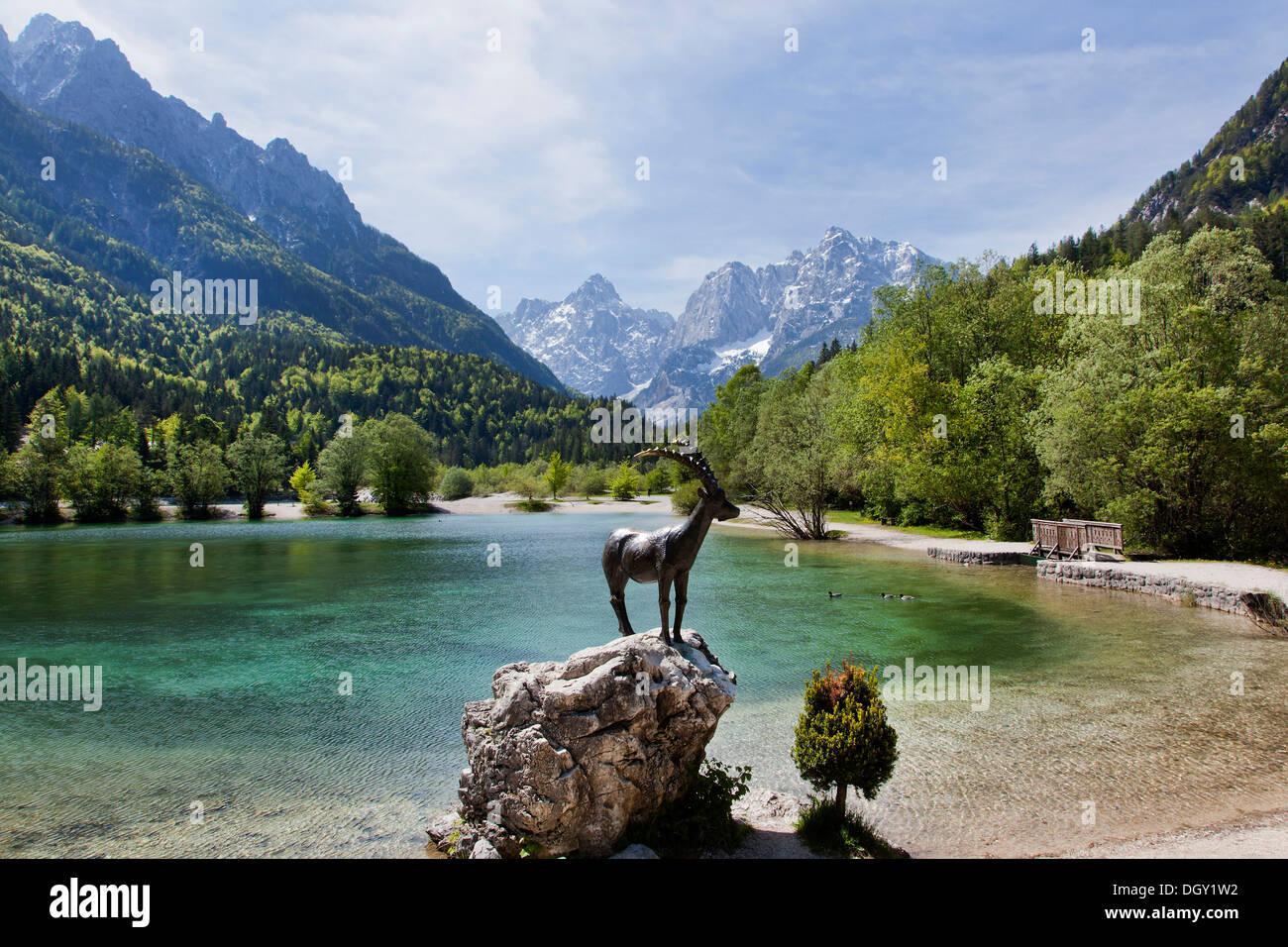 Capricorn sculpture on Lake Jasna in Triglav National Park, Julian Alps, near Kranjska Gora, Slovenia, Europe Stock Photo
