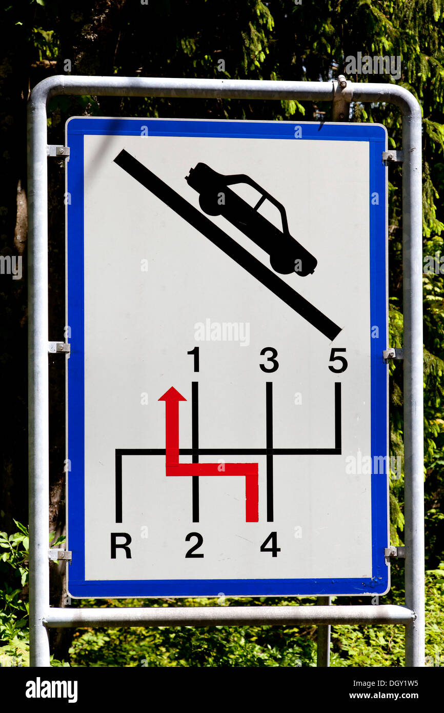 Sign for motorists to switch back a gear, drive slowly on steep slopes, on Wurzen Pass near Villach, Carinthia, Austria, Europe - Stock Image