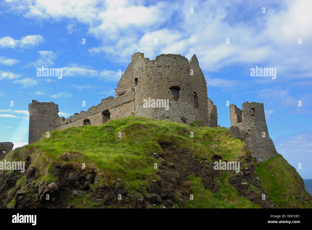 Ancient ruins Dunluce Castle on a cliff on the coast, County Antrim, Northern Ireland, United Kingdom, Europe - Stock Image