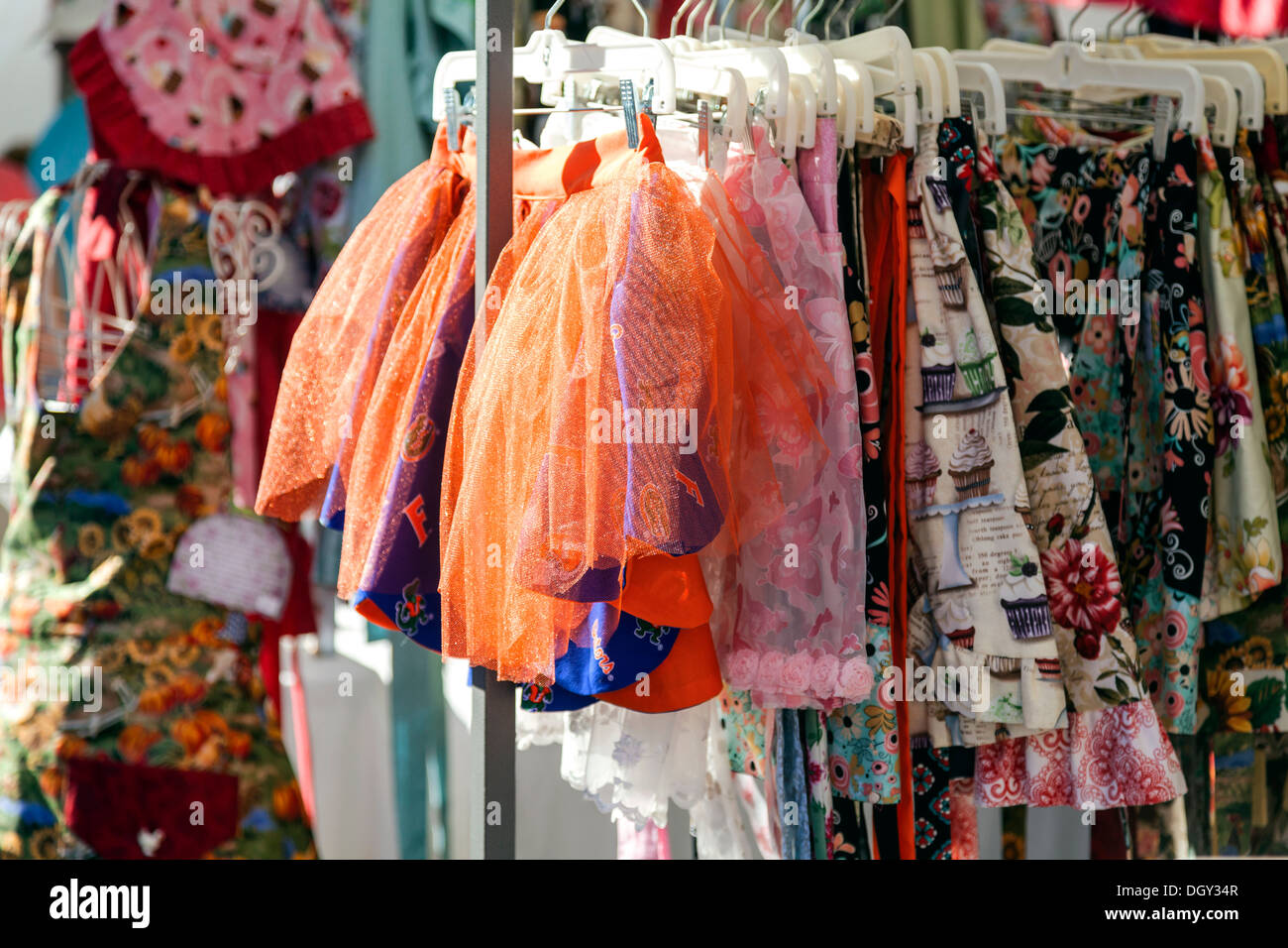Colorful children's skirts, tutus and clothes for sale at the Mount Dora Crafts Fair Festival. - Stock Image
