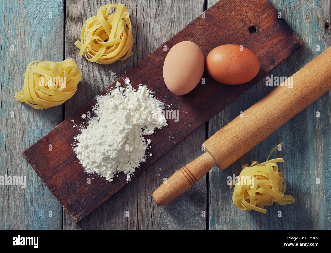 Flour, pasta and rolling-pin on wooden background  - Stock Image