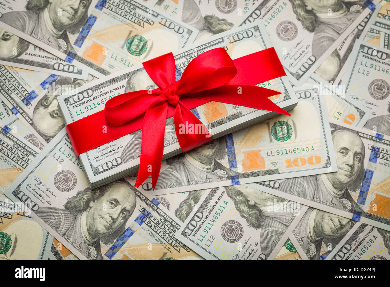 stack of newly designed u s one hundred dollar bills gift wrapped