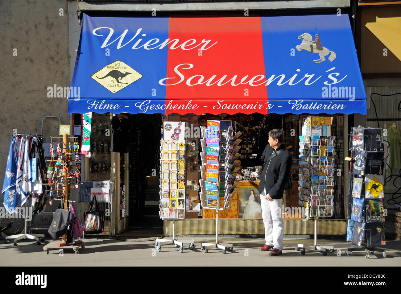 Tourist in front of a store with postcards and souvenirs, Vienna, Austria, Europe - Stock Image