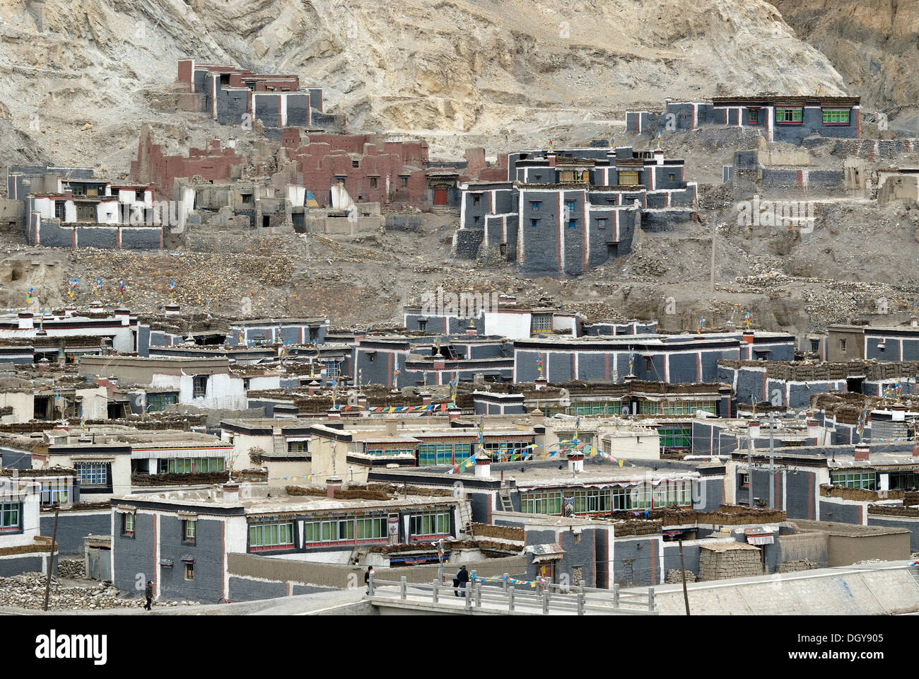 Tibetan temples and monastery built and painted in Sakya architectural style on a mountainside, Sakya, Central Tibet, Tibet - Stock Image