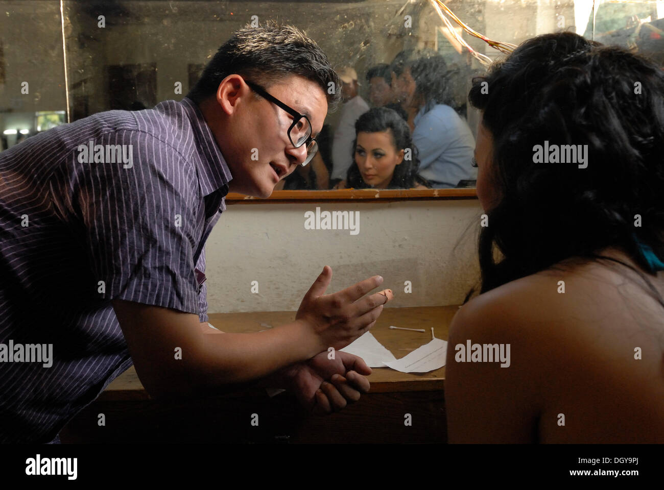 Winner of the Miss Tibet in Exile 2011 beauty contest, Tenzin Yangkyi in Dharamsala, having conversation in make-up room before - Stock Image