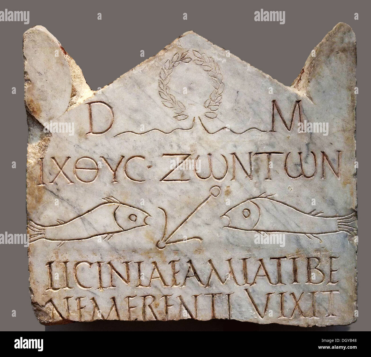5537. Funerary inscription dating early 3rd. C. AD. of a Christian woman called Licinia Amias Terme depicting fish symbols and anker. It was excavated near the Vatican Necropolis. - Stock Image