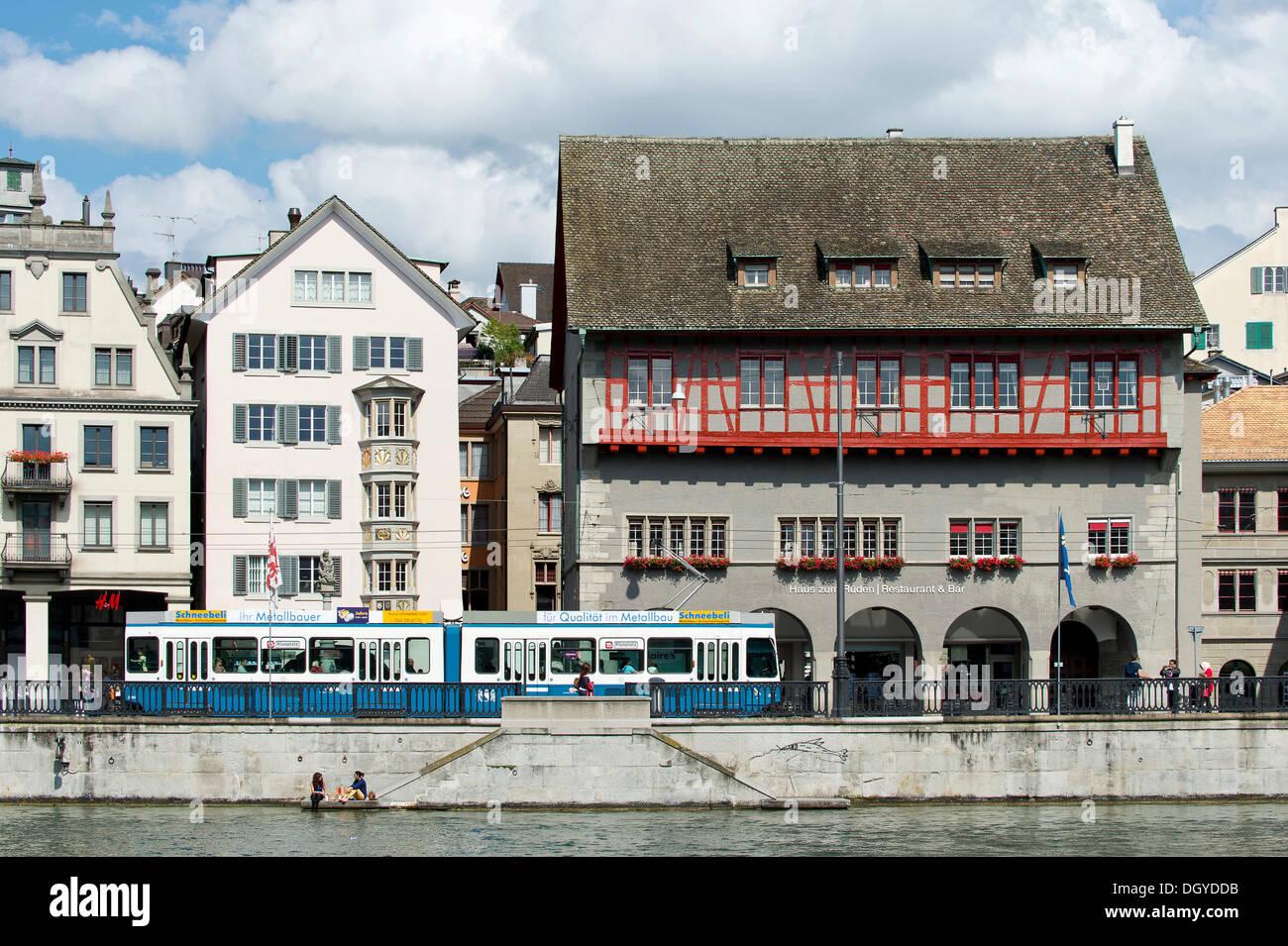 Tram, Limmat river, Limmatquai with the guild house 'Zum Rueden', old town of Zurich, Canton of Zurich, - Stock Image