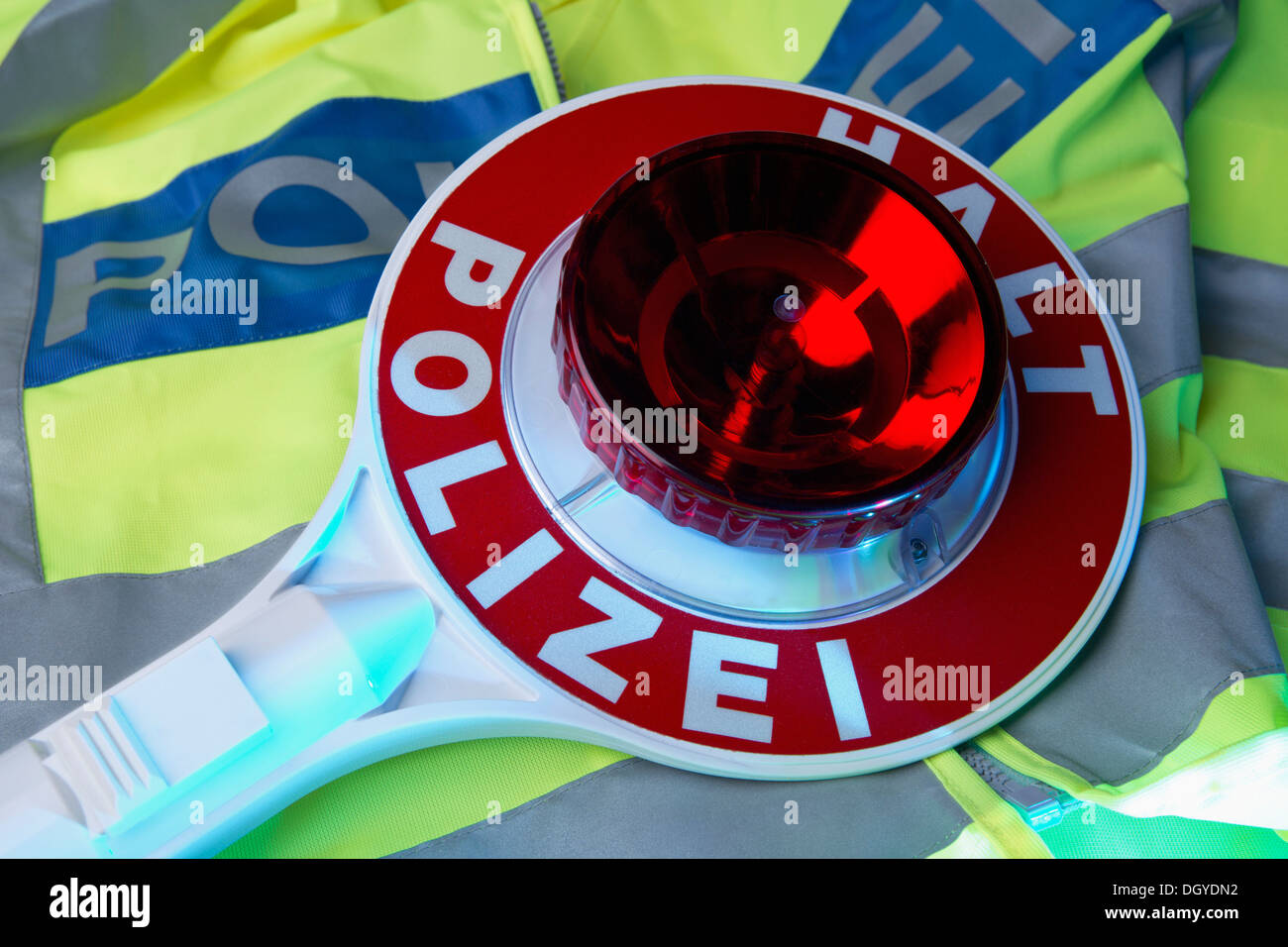 A German Police reflective jacket and a German hand stop sign with Halt Polizei (Stop Police) - Stock Image