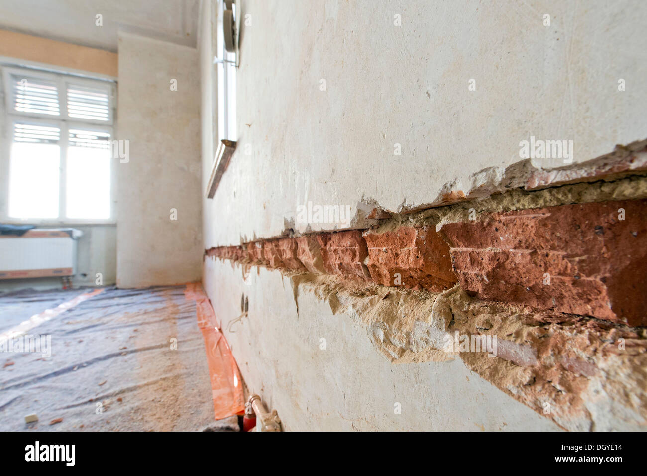 preparatory work on a wall for installing new cable canals and sockets,  flush mounting, electrical wiring in an old building