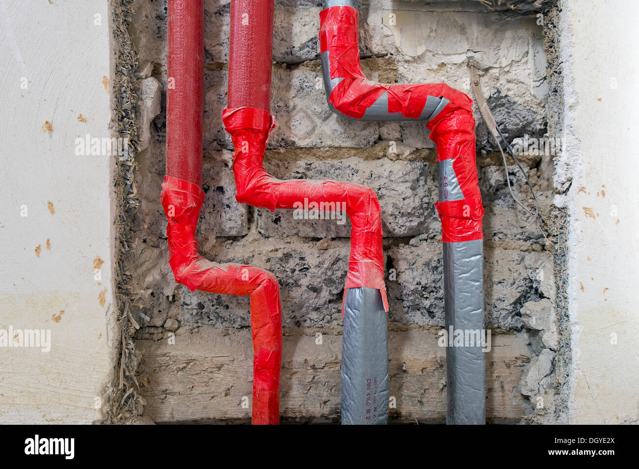 Newly installed heating and water pipes to be flush mounted in an old building, Stuttgart, Baden-Wuerttemberg - Stock Image