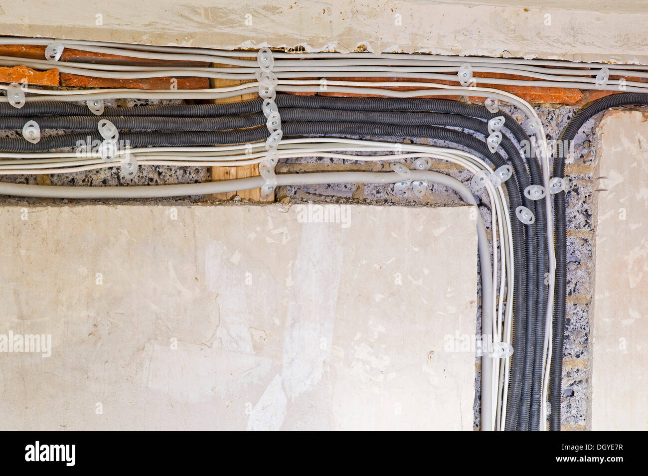 Electric cables laid under plaster in a cable canal in an old building, Stuttgart, Baden-Wuerttemberg - Stock Image