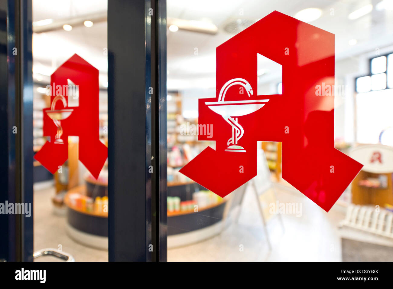 Pharmacy sign, pharmacy logo, a red letter A with the Aesculapian snake on a glass door, pharmacy, Stuttgart, Baden-Wuerttemberg - Stock Image