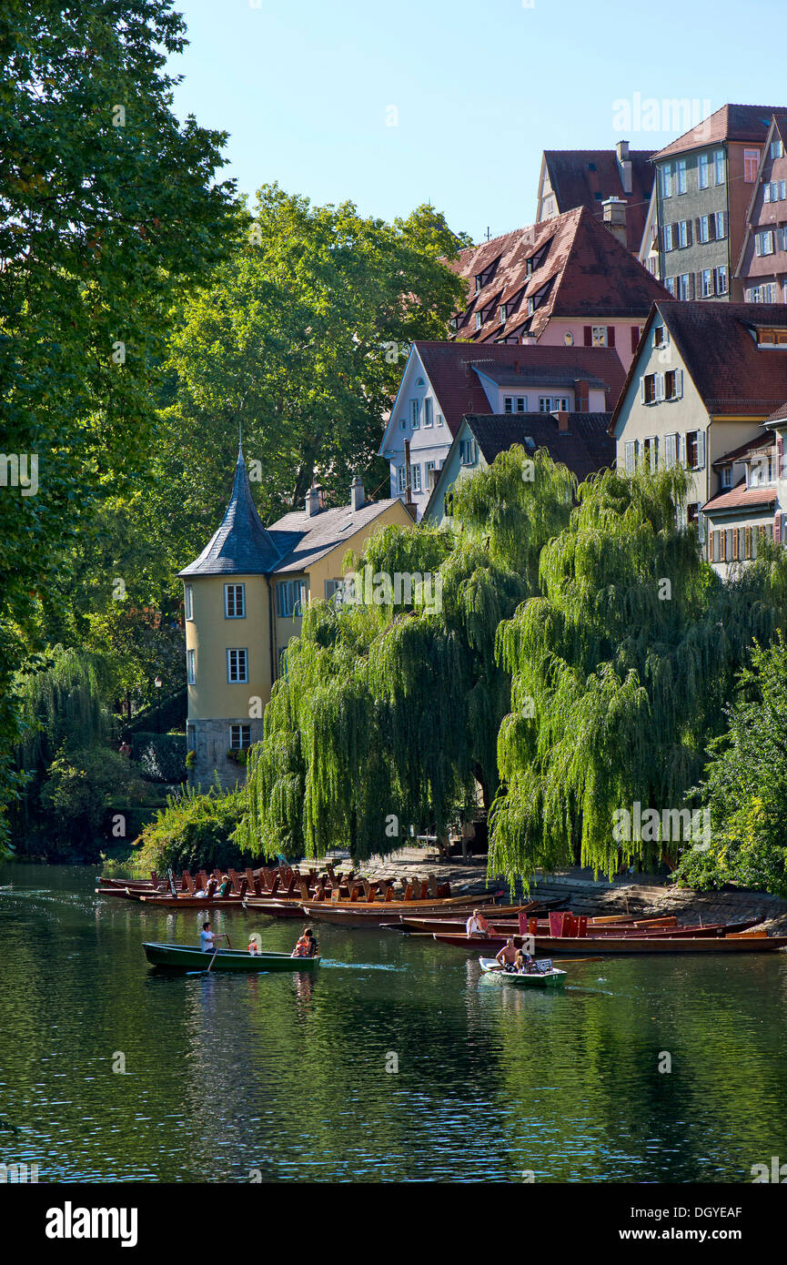 A paddle boat, a rowing boat and a landing stage for punts on the Neckar river, Hoelderlinturm tower at the back, Neckarfront - Stock Image