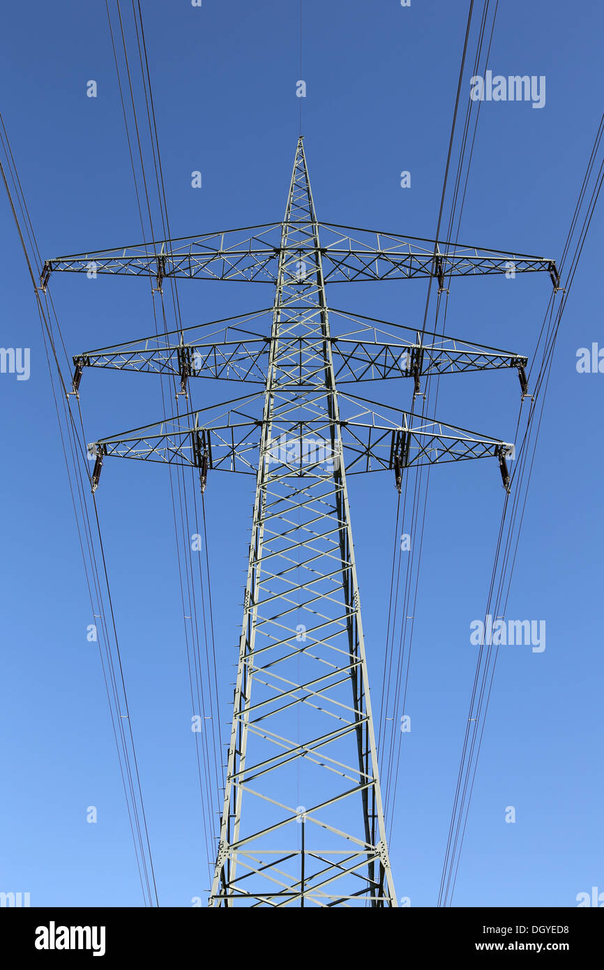Electricity pylon and blue sky, power and energy topic - Stock Image