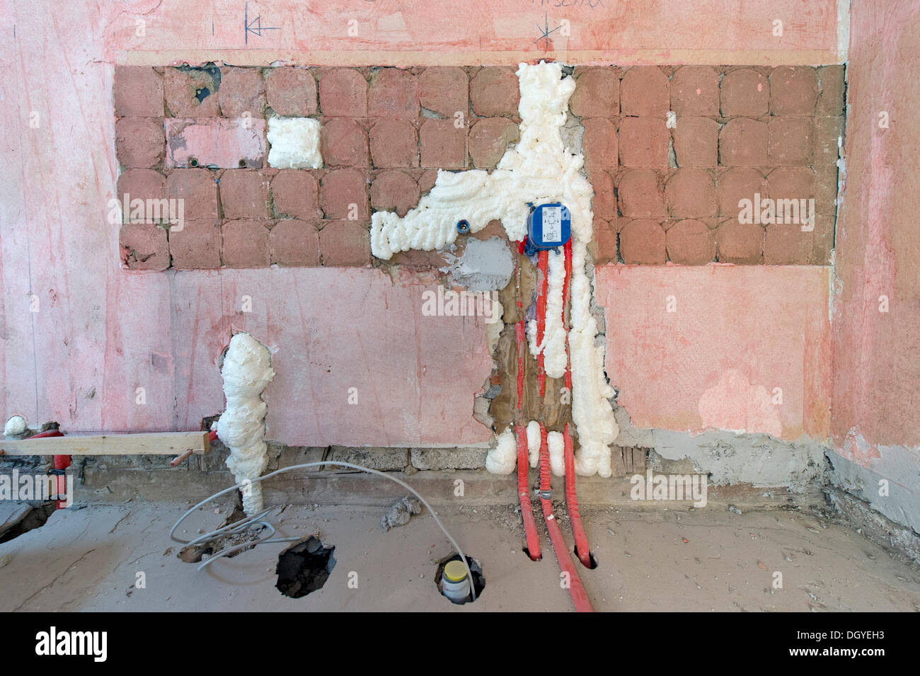 Wall cavities filled with foam insulation, installations for a bathroom, renovation of an old building, Stuttgart - Stock Image