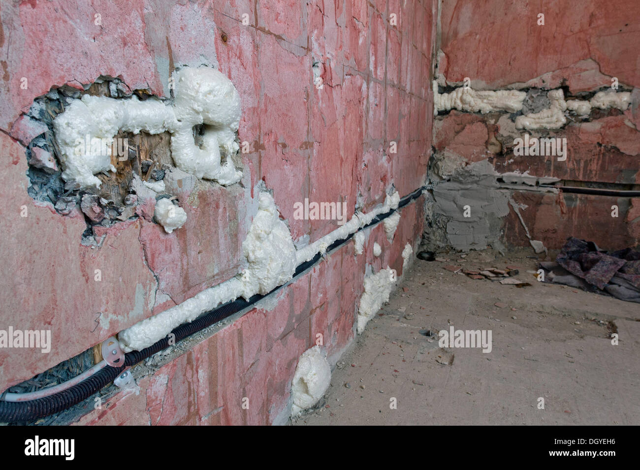Cable channels, wall cavities filled with foam insulation, renovation of an old building, Stuttgart, Baden-Wuerttemberg - Stock Image