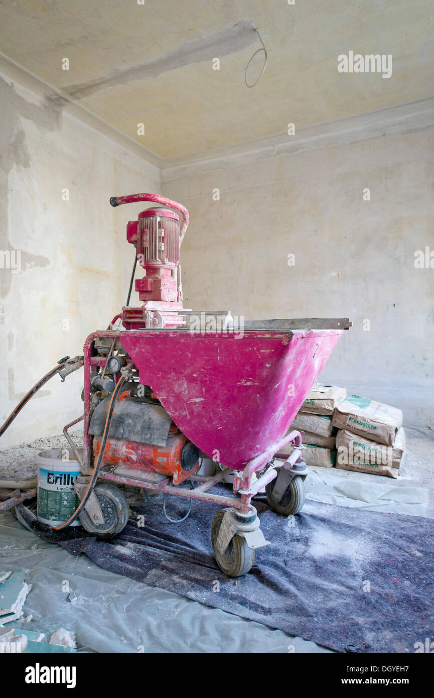 Plastering machine for plastering interior walls, renovation of an old building, Stuttgart, Baden-Wuerttemberg Stock Photo