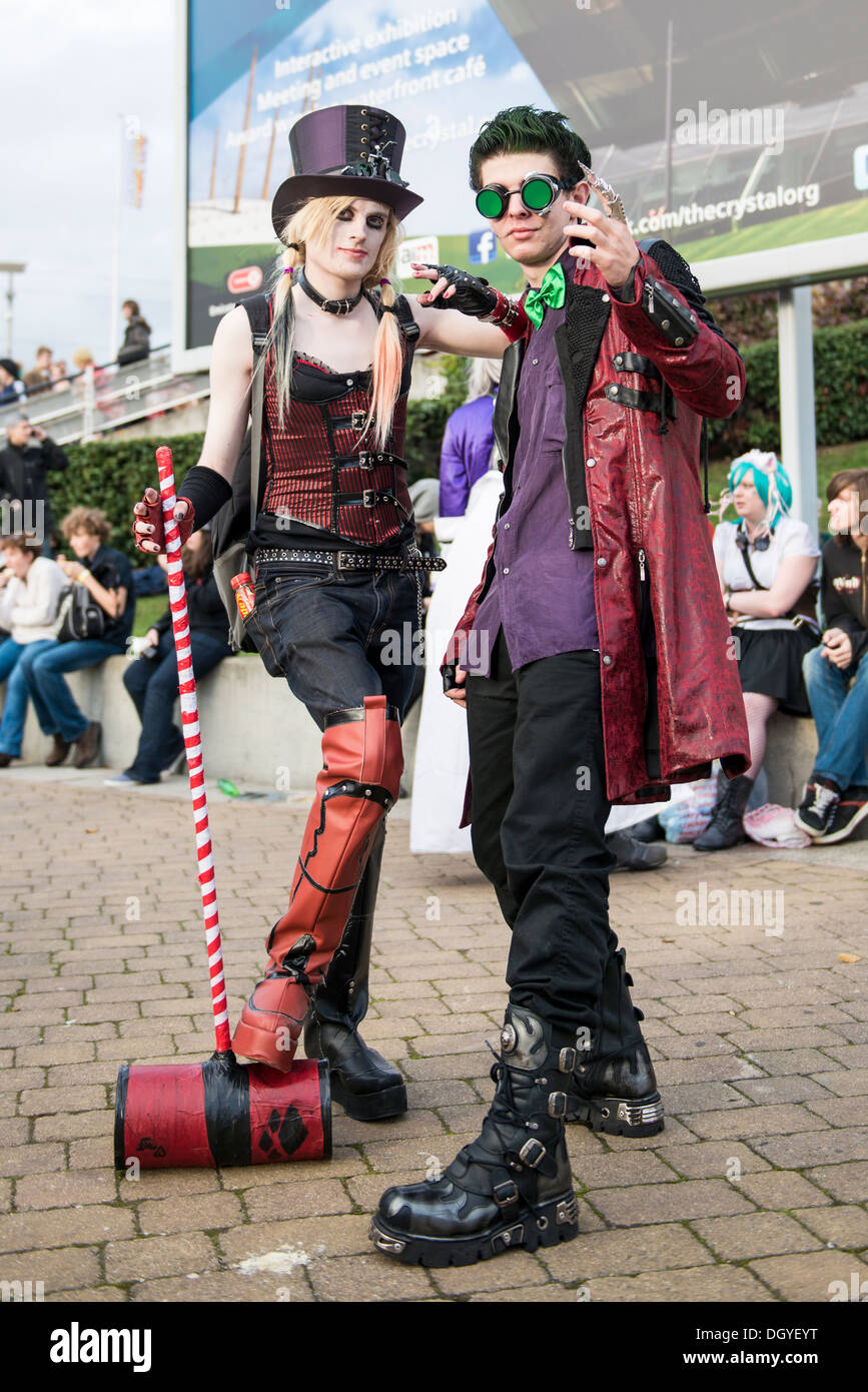 LONDON, UK - OCTOBER 26: Cosplayers dressed as a steampunk version of Harley Quinn and the Joker from Batman for the Comicon - Stock Image