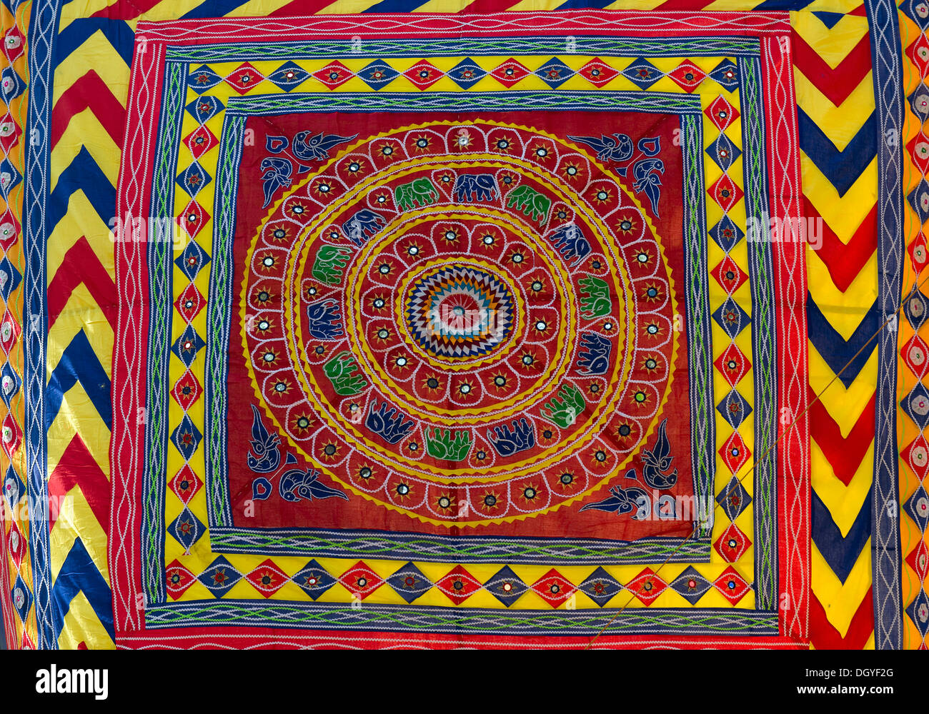 Colourful tapestry with inlaid mirrors, Pipli art from Orissa, Suraj Kund, Haryana, India - Stock Image