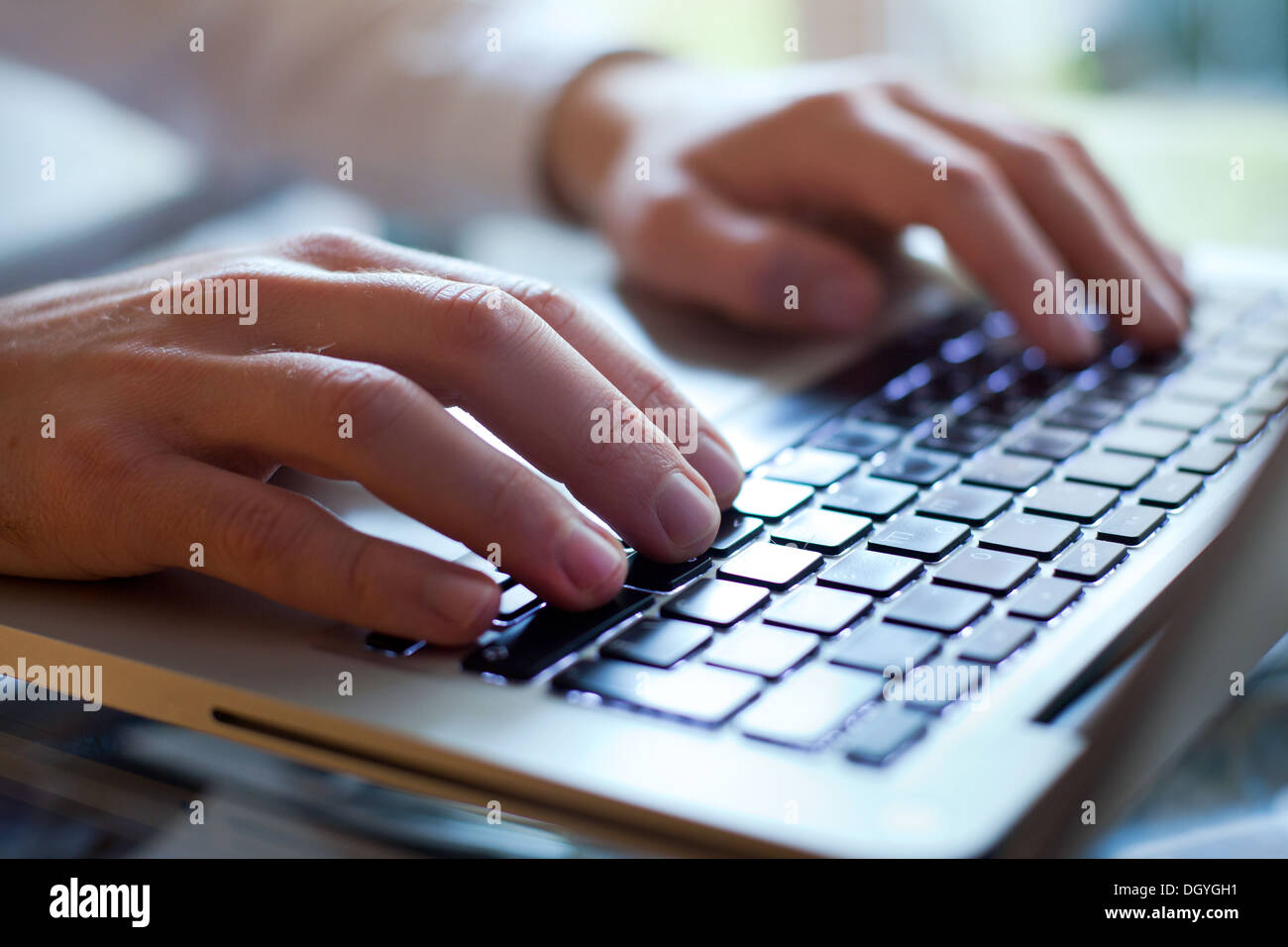 hands of business man type on the keyboard of computer - Stock Image