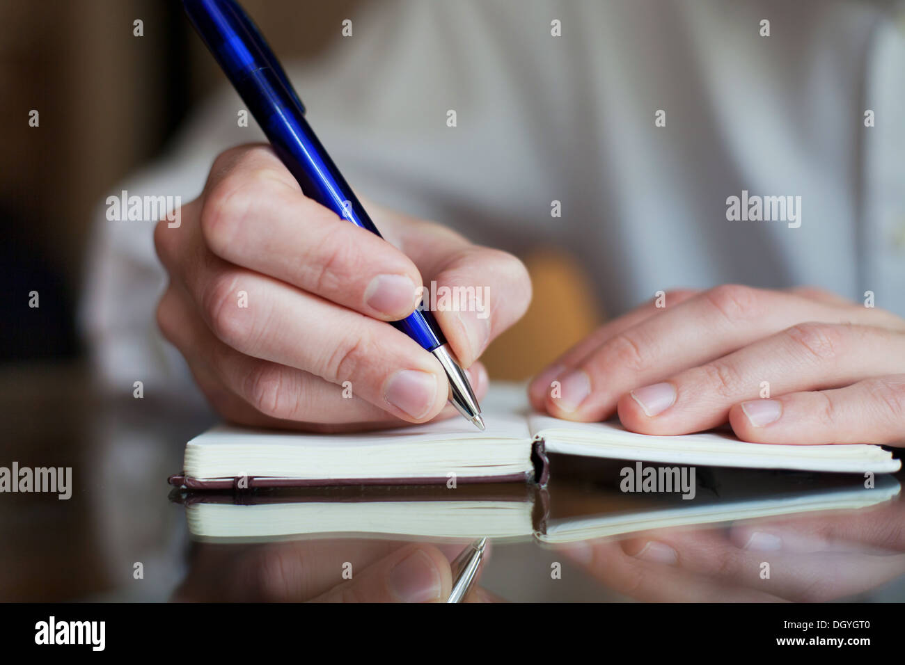 business man write in the notepad - Stock Image