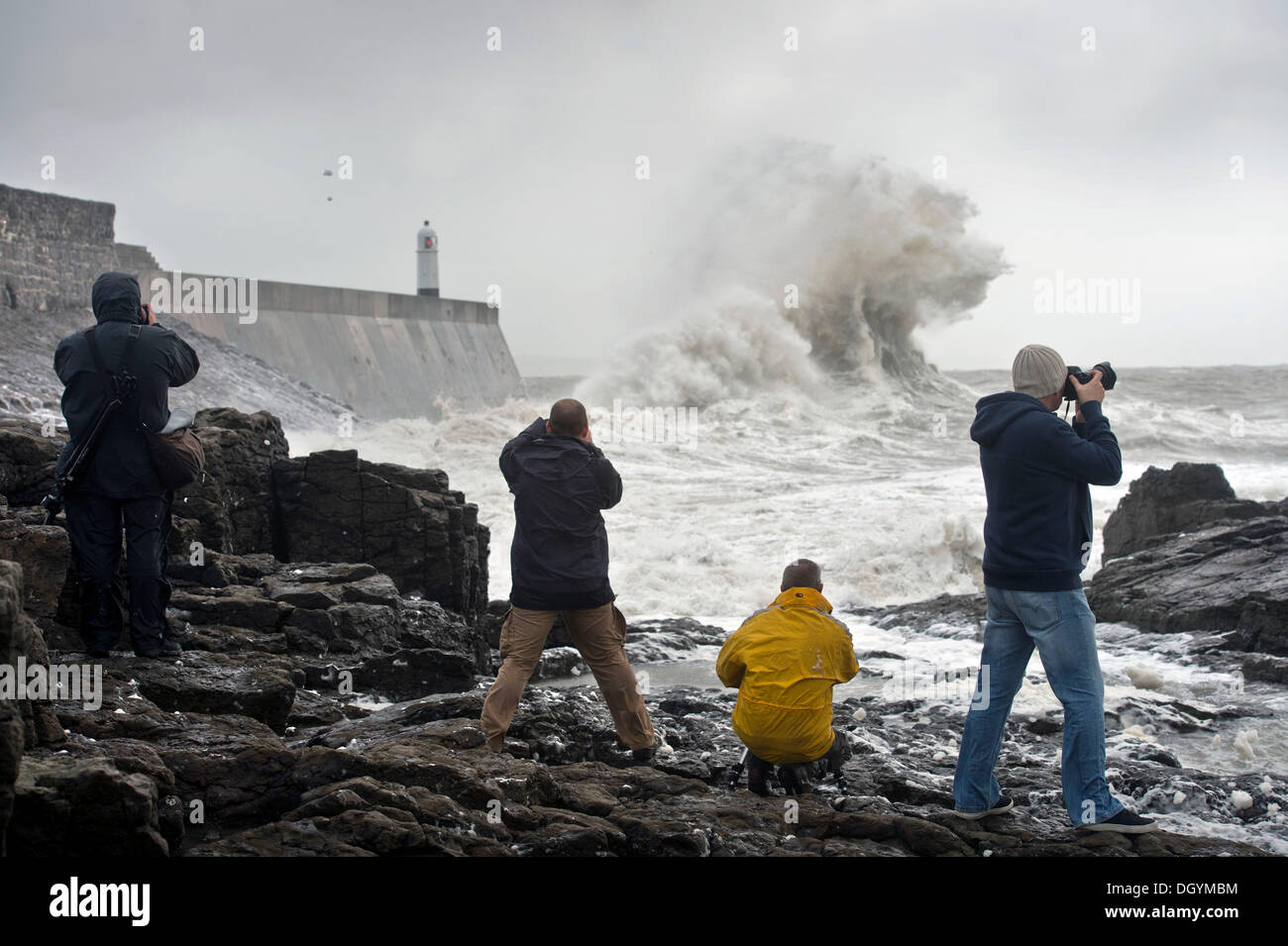 Porthcawl, South Wales, UK. 27th Oct, 2013. Photographers line up to capture the waves breaking over the sea wall at Porthcawl, South Wales (27 Oct 2013)The storm, called St Jude, brought the windiest weather to hit the UK since 1987. © Adrian Sherratt/Alamy Live News - Stock Image