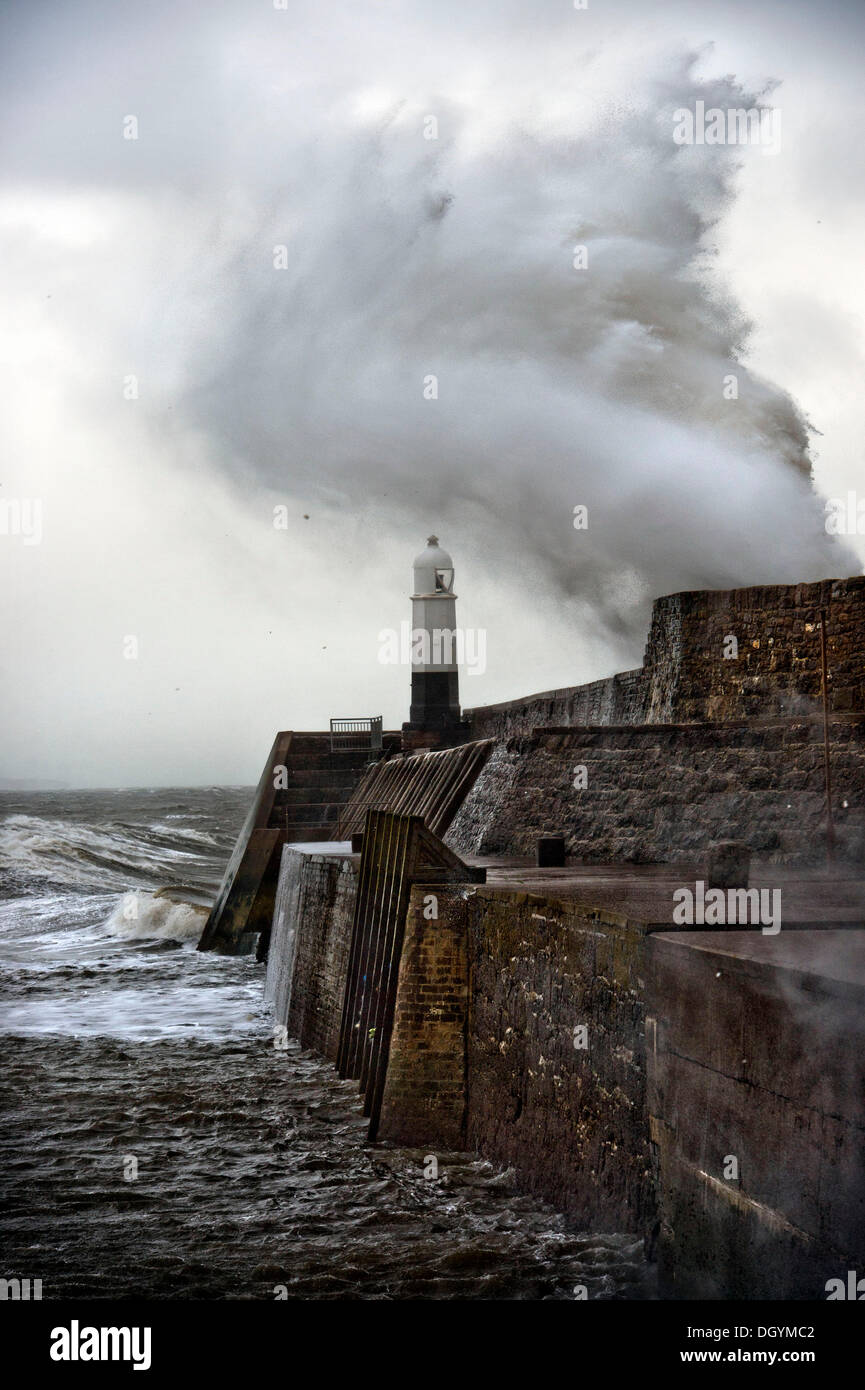 Porthcawl, South Wales, UK. 27th Oct, 2013. A huge wave breaks over the sea wall at Porthcawl, South Wales (27 Oct 2013)The storm, called St Jude, brought the windiest weather to hit the UK since 1987. © Adrian Sherratt/Alamy Live News - Stock Image