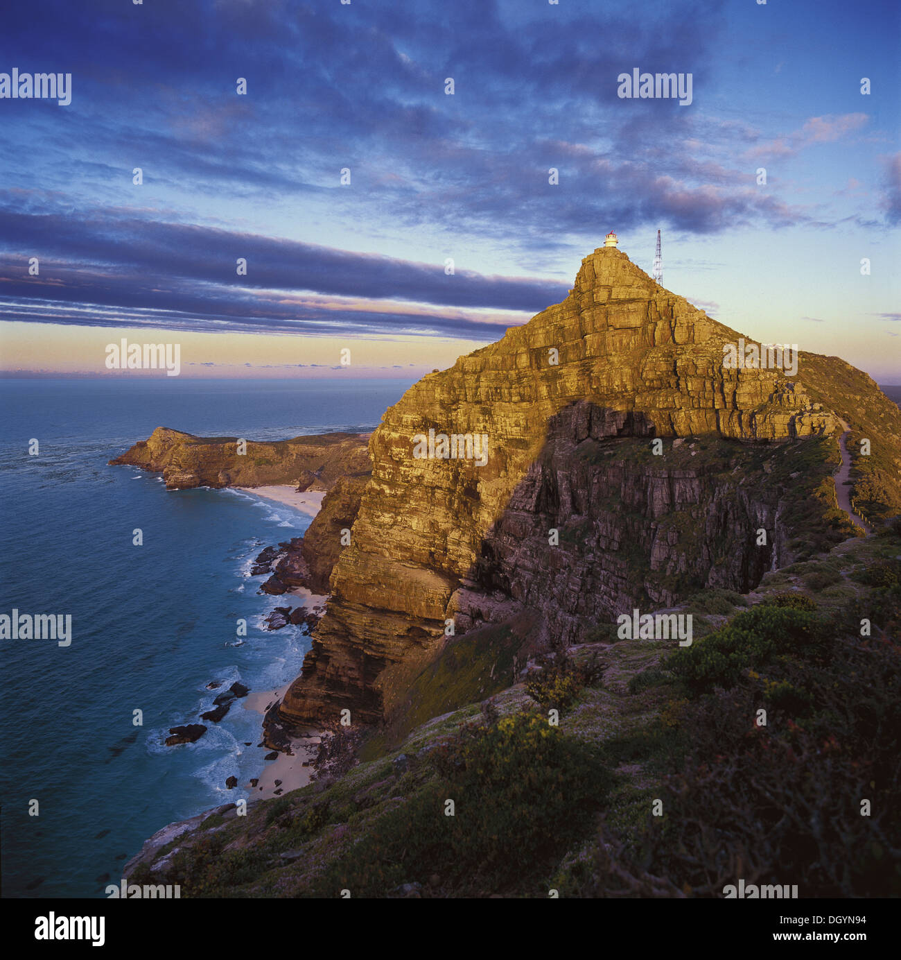 Towering Cliffs rise up against the ocean like stately sentinels at Cape Point - Stock Image