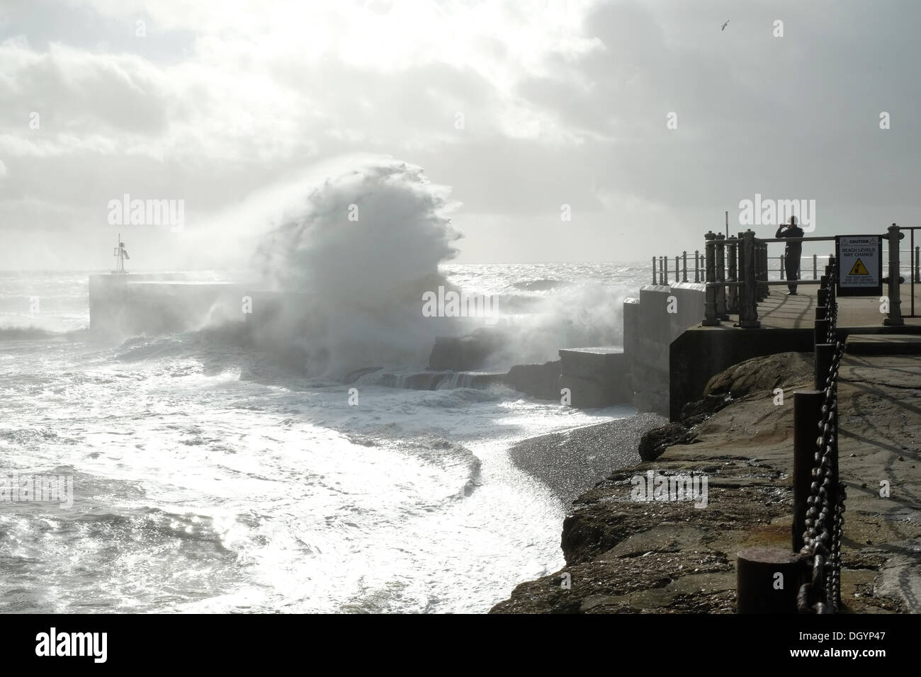 Hastings Harbour, East Sussex, UK. 28th Oct, 2013. Photographer gets close to capture waves breaking over the harbour Stock Photo