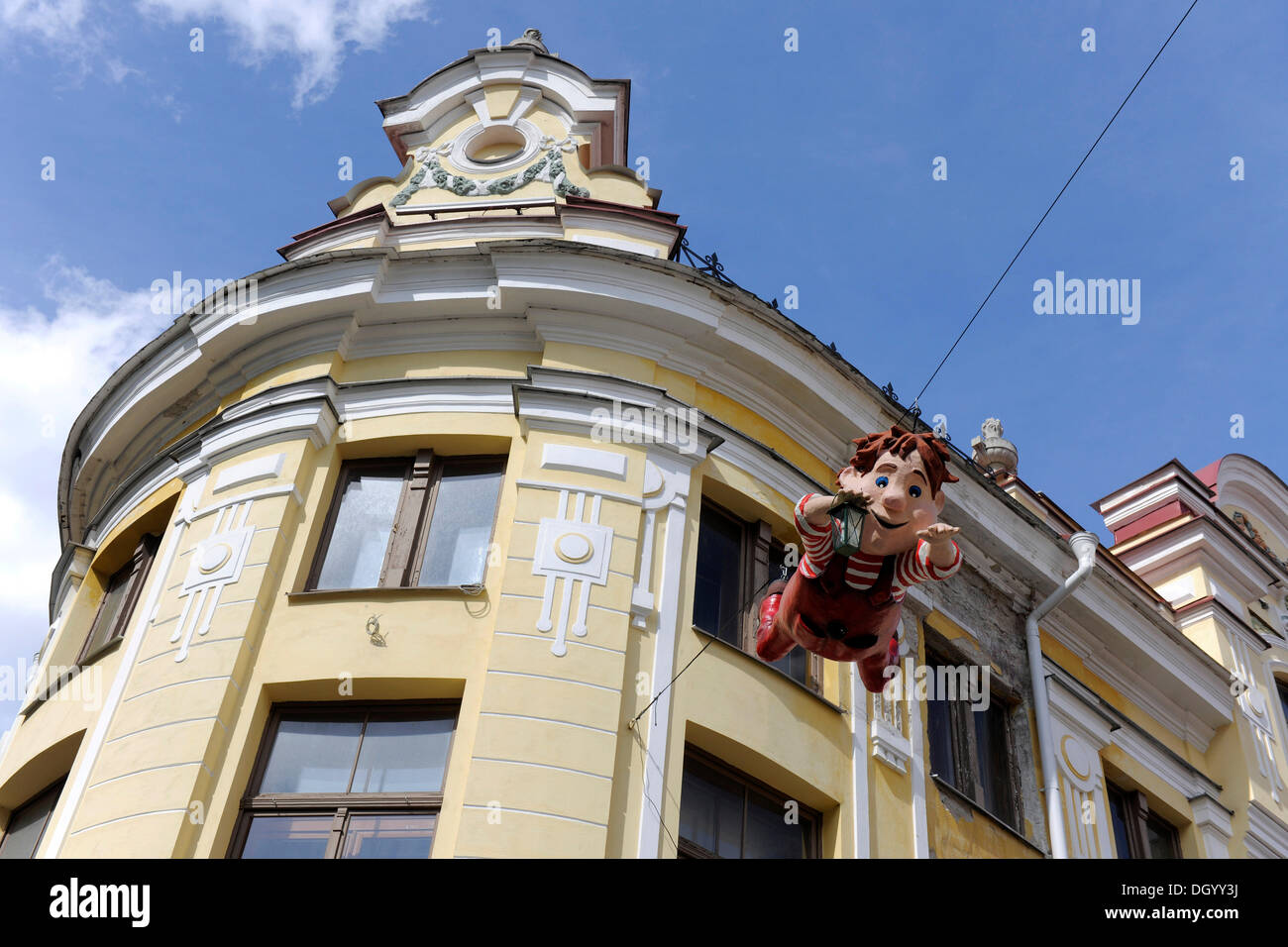 Comical figure with lantern, decoration on a building facade, Tallinn, Estonia, Northern Europe, Europe - Stock Image