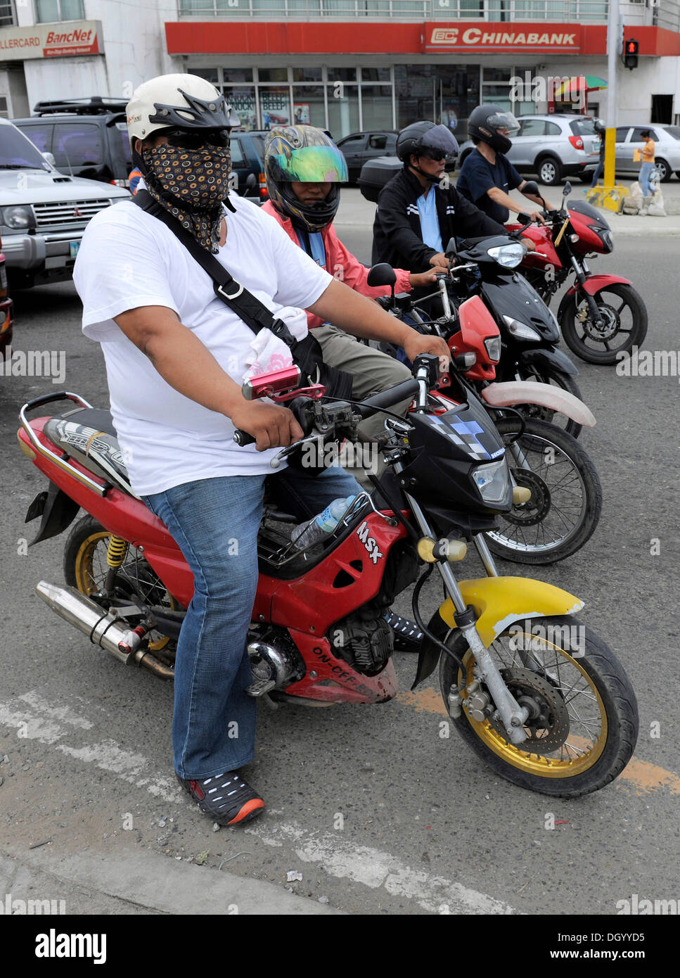 Overweight man on a motorcycle, Cebu, Philippines, Southeast Asia, Asia - Stock Image