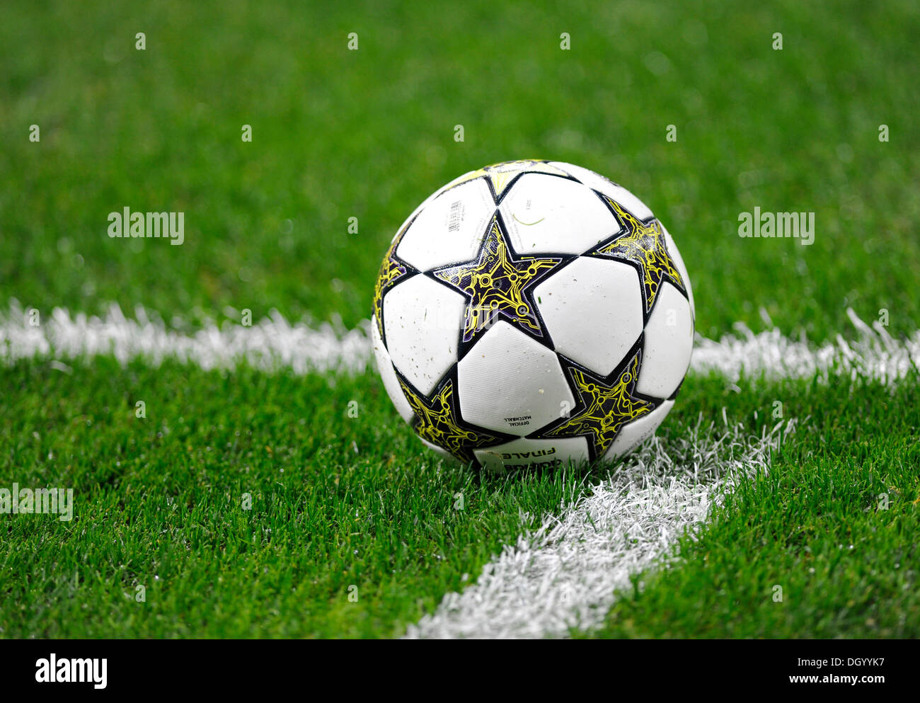 Adidas football lying on a football pitch - Stock Image