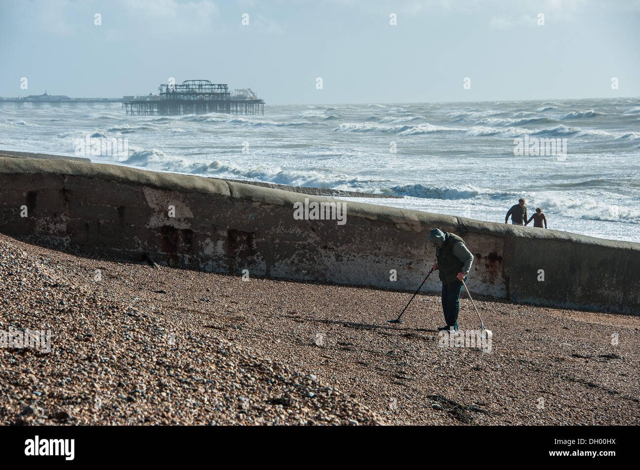 Brighton, UK. 28th Oct 2013. Treasure hunters search the shingle in the aftermath of the storm on Brighton beach. Stock Photo